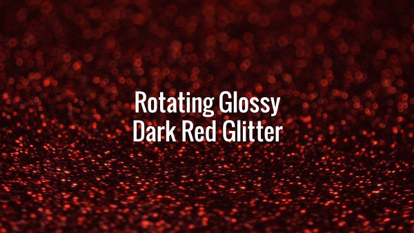 Seamlessly looping rotating shiny dark red glitter particles