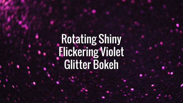 Seamlessly looping spinning flickering violet glitter particles on dark surface.