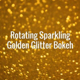 Seamlessly looping spinning flickering golden glitter bokeh.