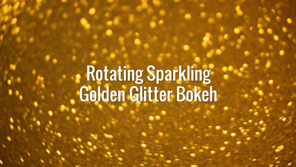 Seamlessly looping spinning flickering golden glitter bokeh.