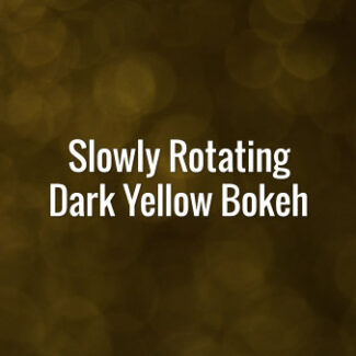 Seamlessly looping spinning flickering dark yellow glitter particles on dark surface.