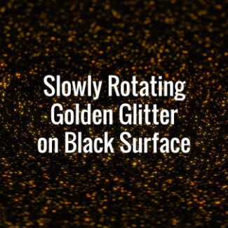 Seamlessly looping slowly rotating golden glitter particles on dark floor.