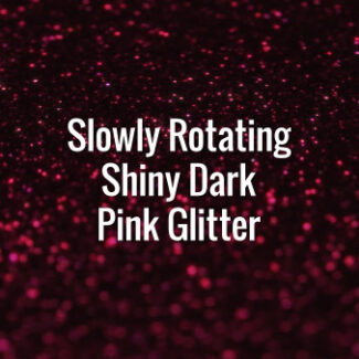 Seamlessly looping spinning flickering pink glitter bokeh on dark surface.