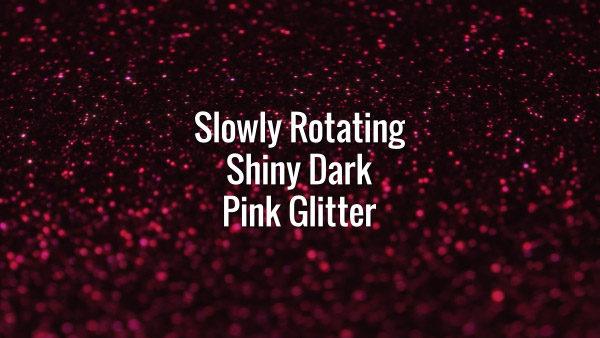 Seamlessly looping spinning flickering pink glitter bokeh on dark surface.