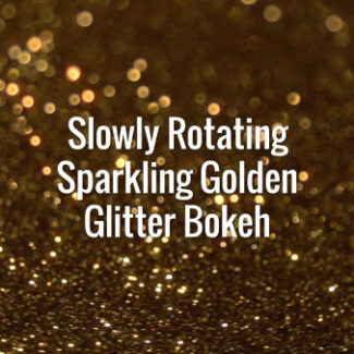 Seamlessly looping slowly spinning flickering dark golden glitter particles.