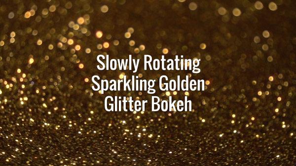 Seamlessly looping slowly spinning flickering dark golden glitter particles.