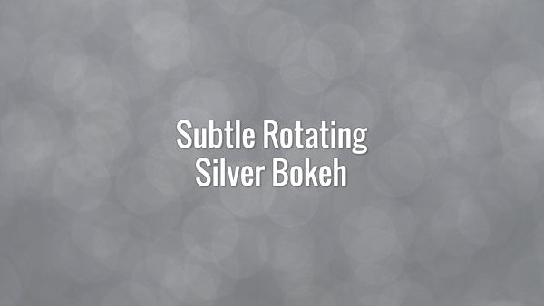 Seamlessly looping spinning flickering subtle silver glitter particles.