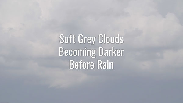 Time-lapse video of overcast sky. Gray floating clouds getting darker foreshadowing heavy rain.