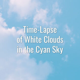 Time-lapse video of white clouds in the cyan sky on a summer day